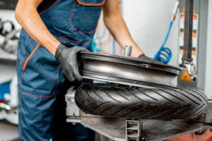 Breaking the bead of a motorcycle tire