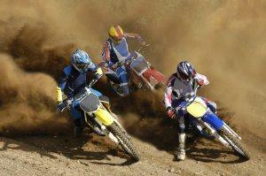 3 people on off-road motorcycles racing