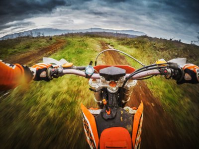 Rider on dirt bike tracks