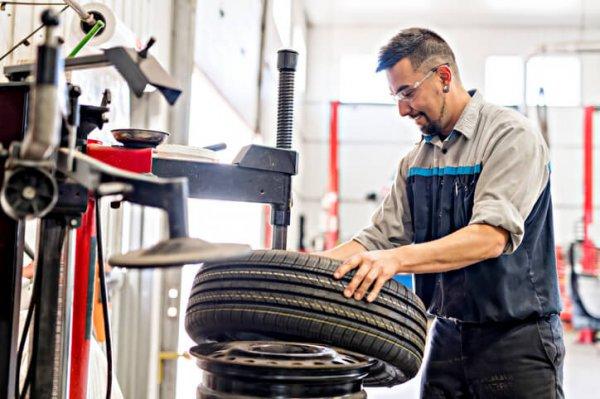 Mechanic changing passenger tires