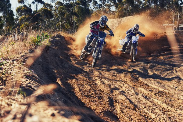 Two riders on dirt bikes track days